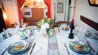Dining experience at a Cesarina's home in Milan with show cooking