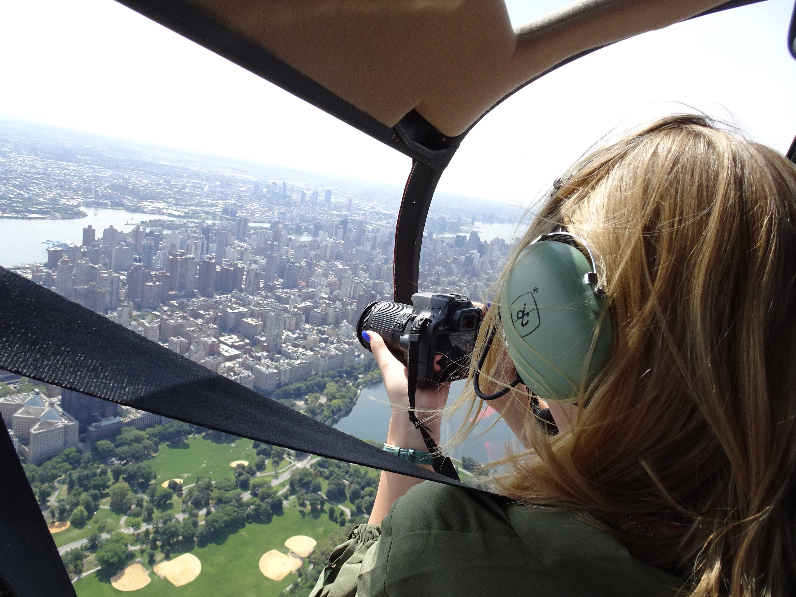 Fly in a helicopter over New York City