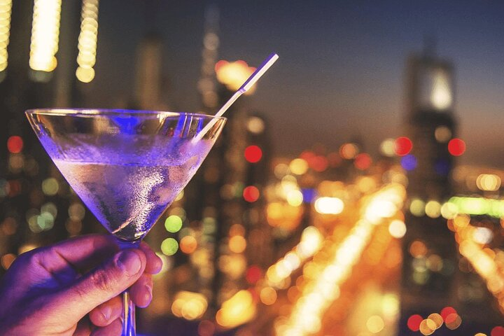 Guided Pub Crawl in Dubai with Transport and Drinking Games