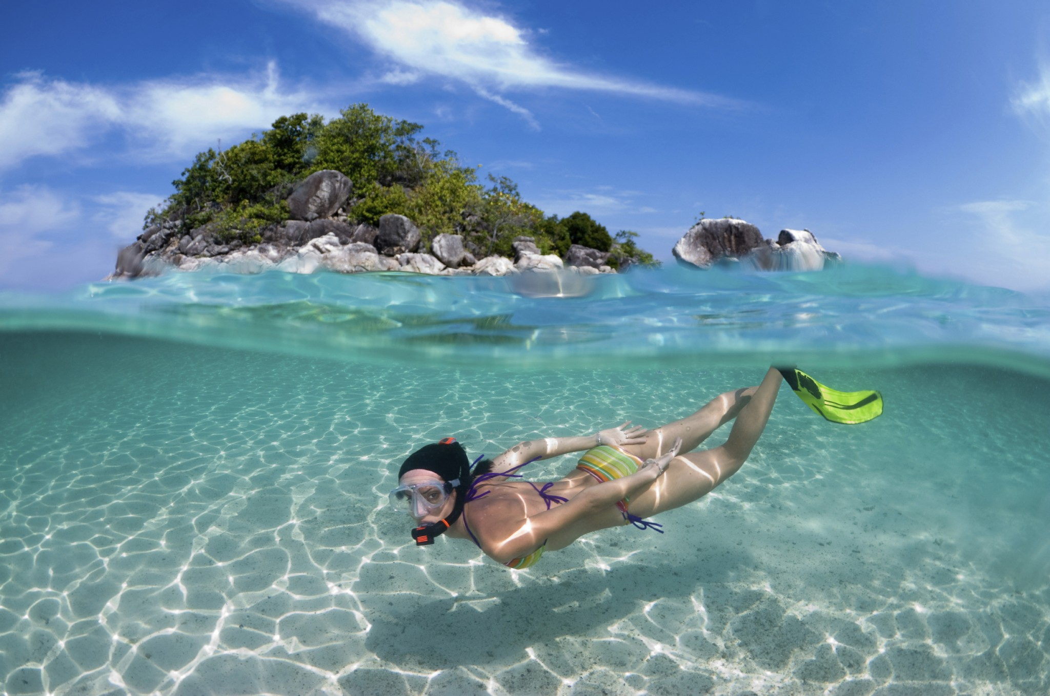 Go snorkeling in the clear blue waters.
