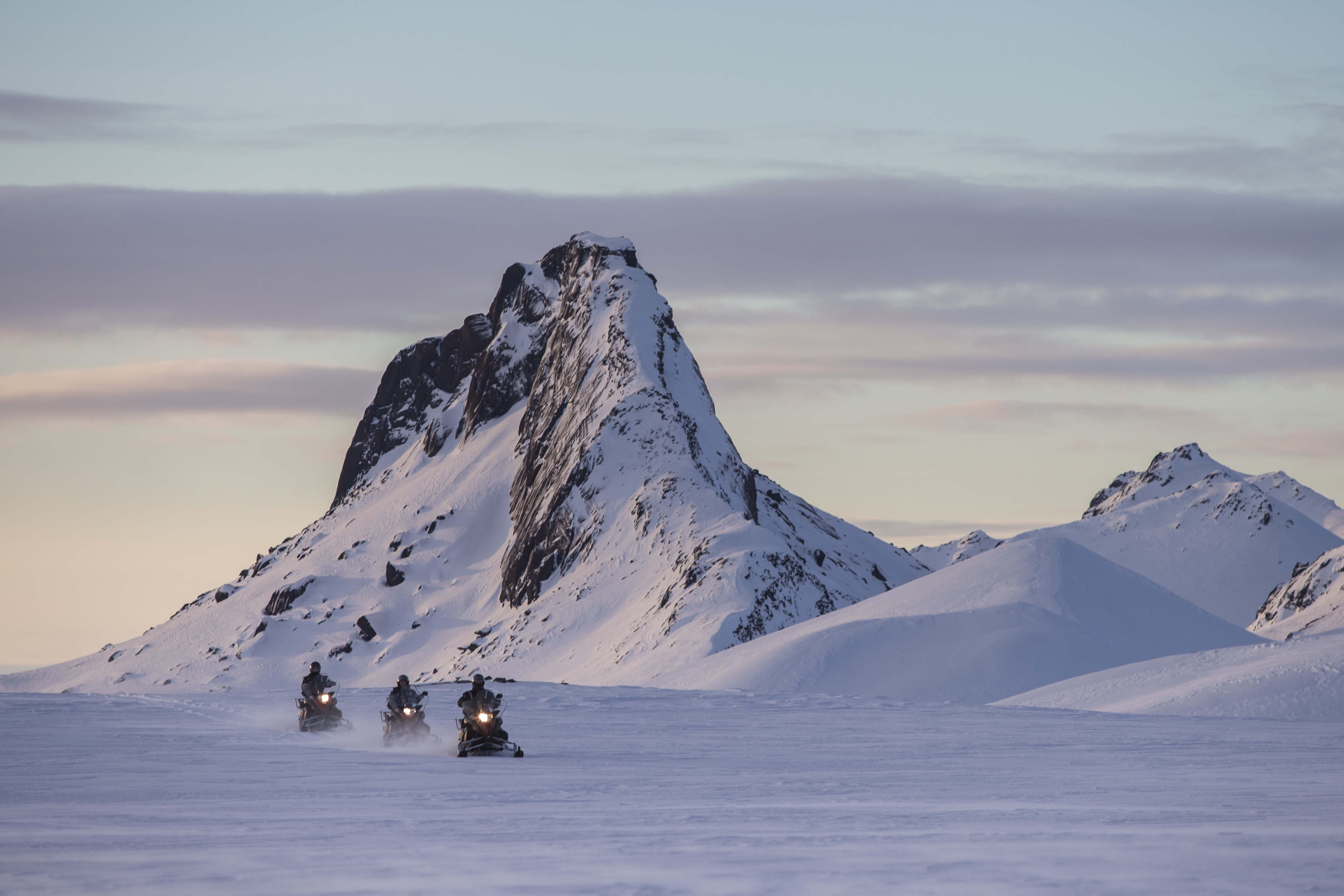 Ride on the snowmobile across the glacier.