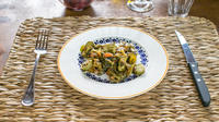 Dining experience at a Cesarina's home in Pisa with show cooking