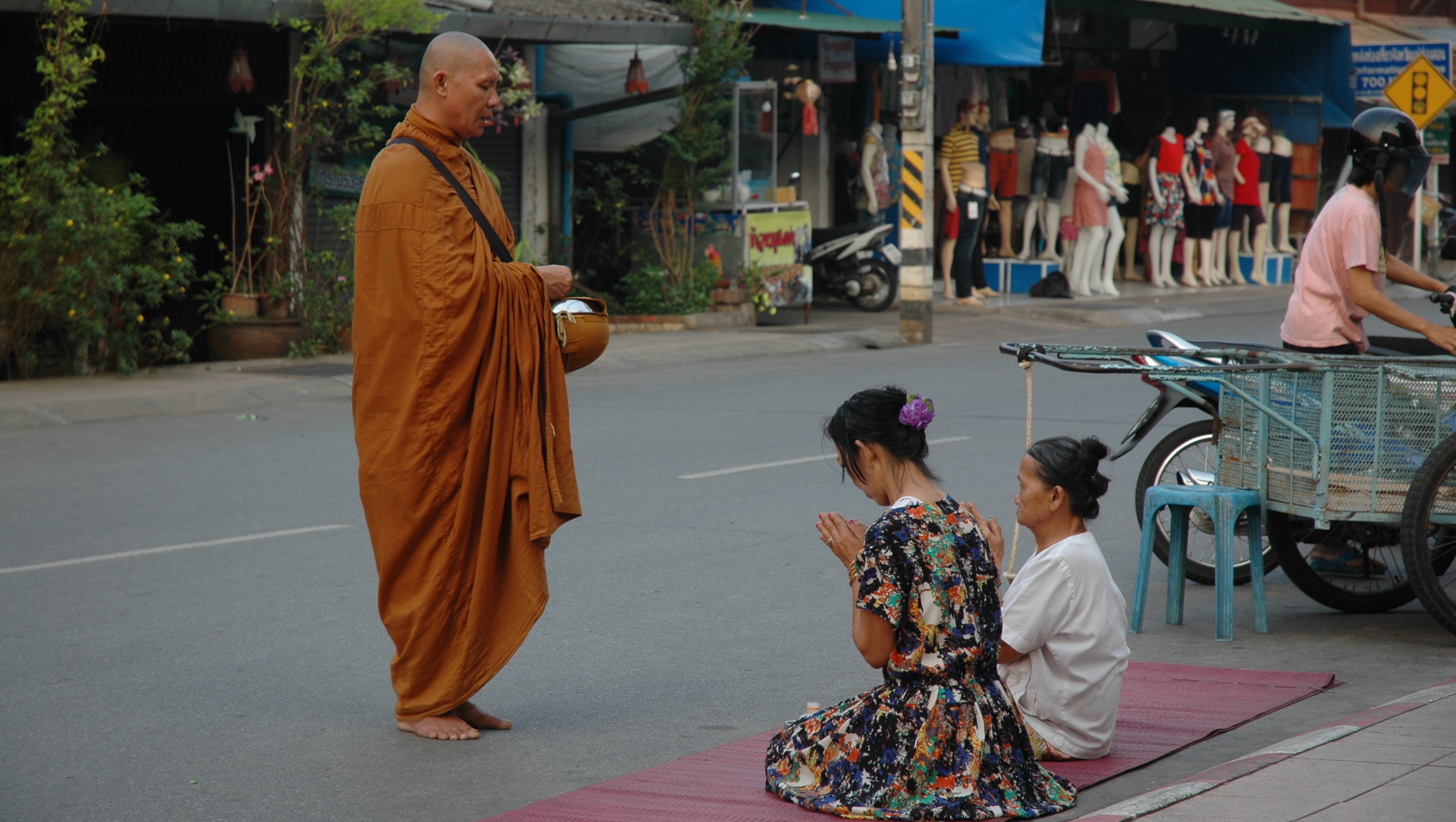 See the locals offer food to the monks.