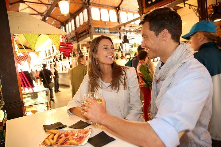 Spanish cuisine masterclass in Madrid: local market, wine tasting & tapas tour