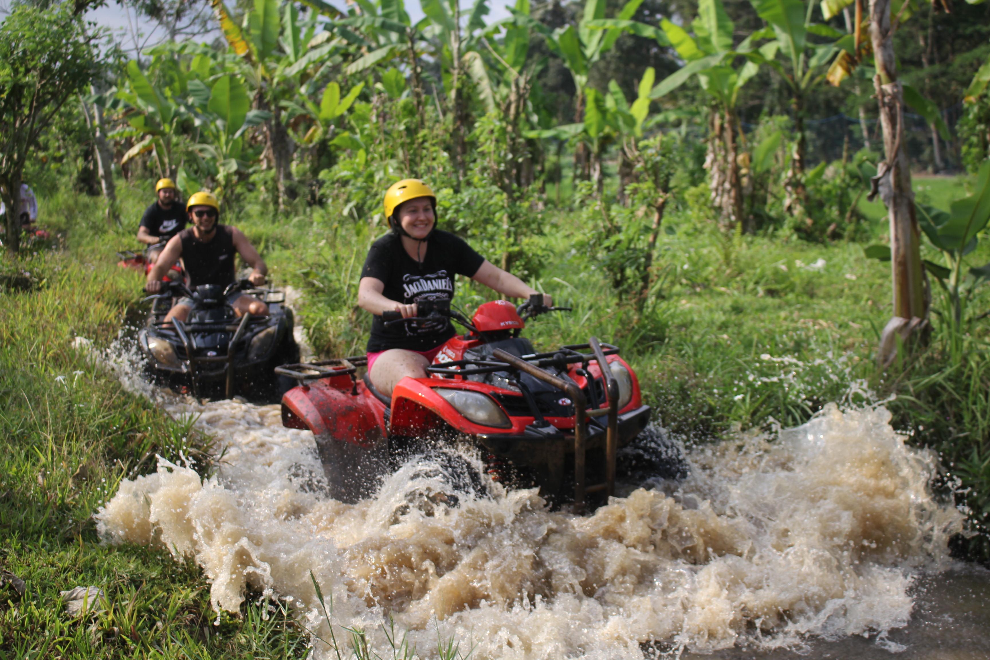 Splash some mud riding an ATV.