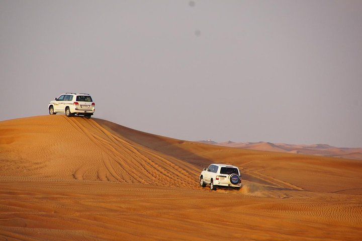 Dubai Desert Safari with BBQ Dinner and Dance Performances