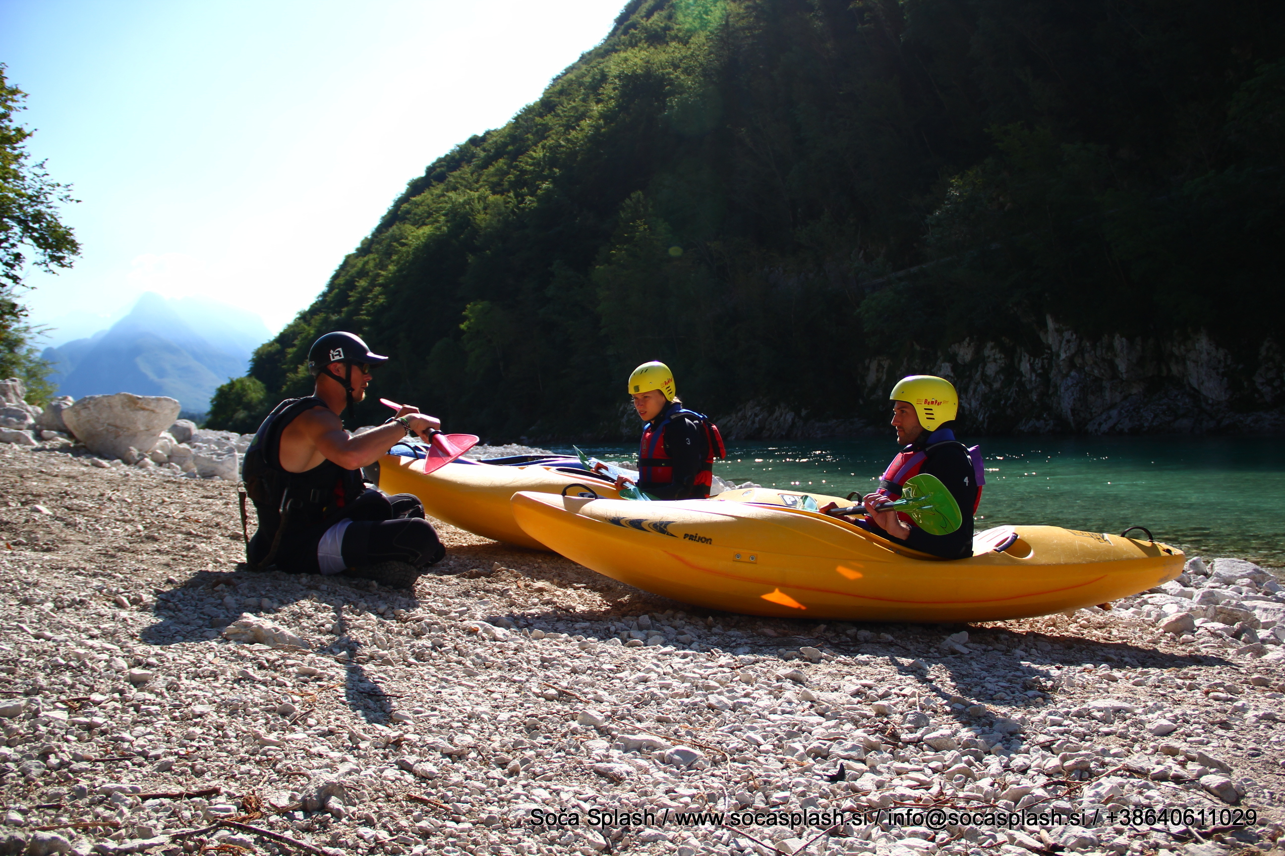 Prepare for a kayaking course on the Soca River
