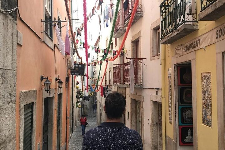 Walking down a narrow street.