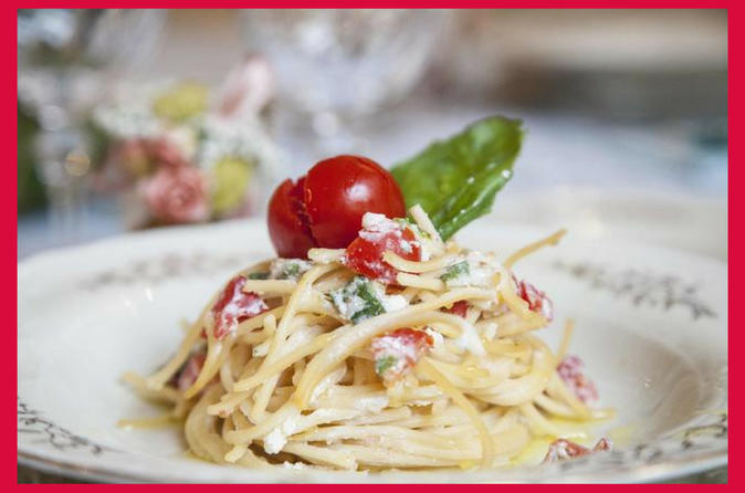 Dining experience at a Cesarina's home in Naples with show cooking