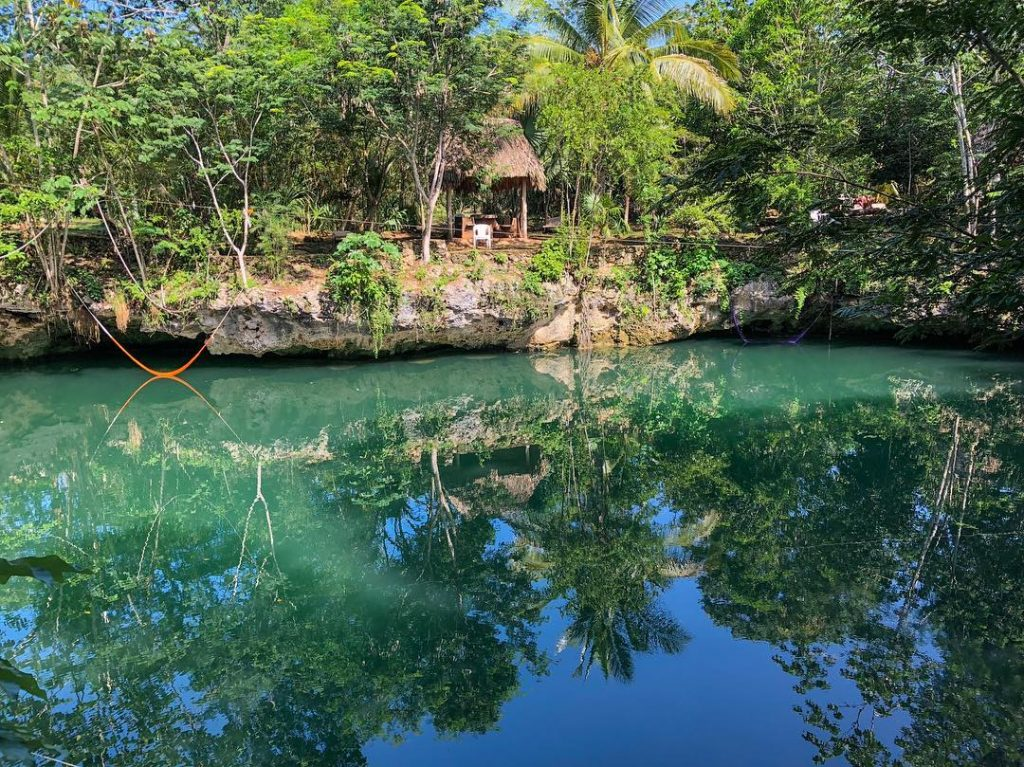 Take in the stunning cenote