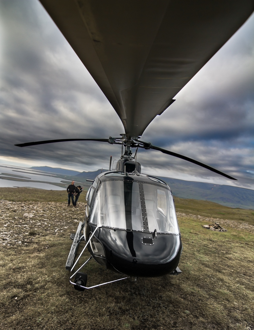Fly in a helicopter over Reykjavik